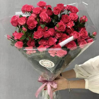 9 кустовых роз в упаковке